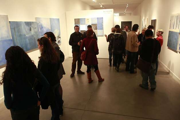 "People visit the ""Variations"" exhibit by Eric Bohr at the Mercury 20 Gallery, one of several galleries that are part of Oakland Art Murmur's First Friday Art Walk on the first Friday night of every month. Nine new galleries have been added to the list as the event that has drawn thousands continues to grow. Photo: Jill Schneider, The Chronicle"