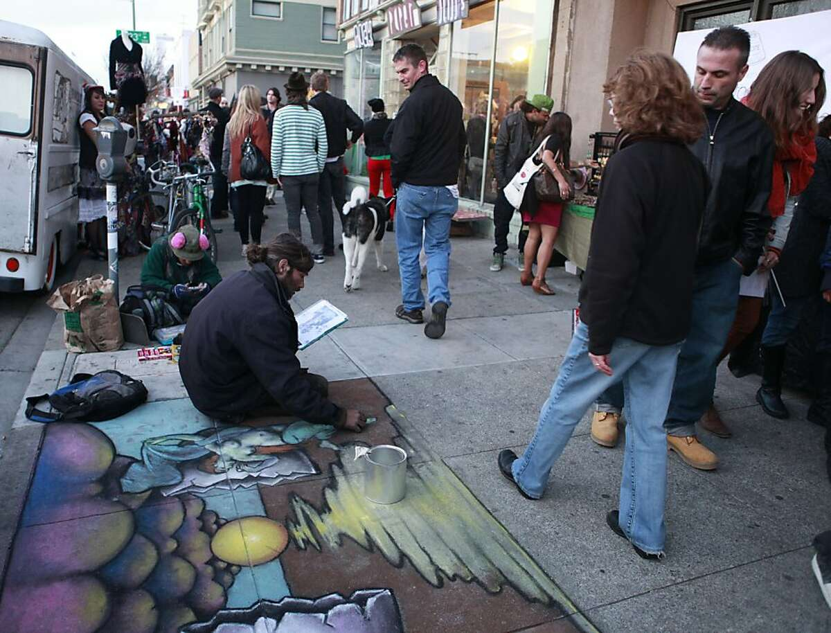 Artists display their work as visitors stroll on Telegraph Avenue at 23rd Street, the heart of Oakland Art Murmur's First Friday Night Art Walk, which has grown to include 21 galleries.