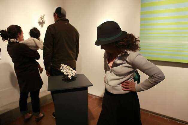 Visitors check out pieces at the Chandra Cerrito Contemporary Gallery. Families are among the diverse visitors taking advantage of the art walks. Photo: Jill Schneider, The Chronicle