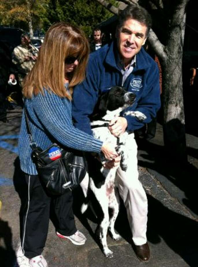 "Perry poses with Beauregard the rescue dog in January while campaigning in South Carolina. A report from ABC News on Jan. 14 said Perry had been courting the approval of the dogs as much as the human's - when someone said their dog supported Perry he responded with, ""They all are. Dogs have the best instincts."" (@Governorperry - Twitter)"