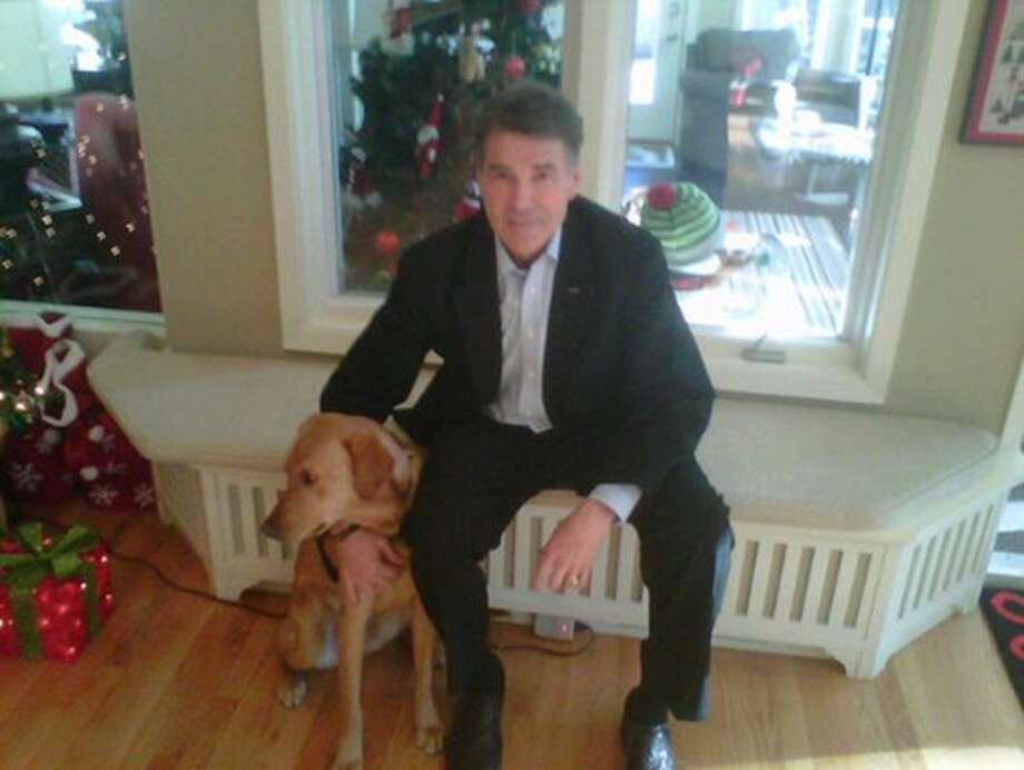 Perry didn't name the pup in this pic, but it's a holiday greeting all the same. (@Governorperry - Twitter)