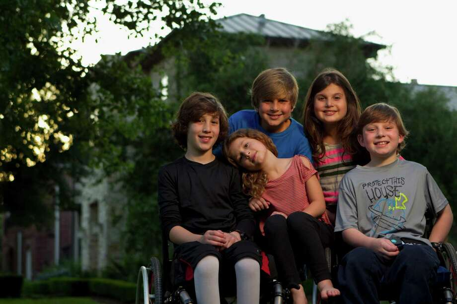 Peter, 10, Willa, 6, and Aaron Berry, 9, spend time with their cousins, Noah, 10,  Misha, 9, back. the Berry kids live with their cousins in Bellaire.  Peter, Willa and Aaron survived the car accident that killed their father and mother, Josh and Robin Berry, on July 2, 2011, in West Texas while on their way back from a family vacation in Colorado. The accident resulted in spinal cord injuries to their two sons, leaving them unable to walk, and Willa, 6, less seriously injured and recovered.  The driver of the other vehicle, Michael Scott Doyle, who caused the accident by crossing into the oncoming lane wile reaching for a DVD in his SUV, survived, along with his 1-year-old daughter. His wife, Colleen, 28, also died in the accident. Photo: Johnny Hanson, Houston Chronicle / © 2012  Houston Chronicle