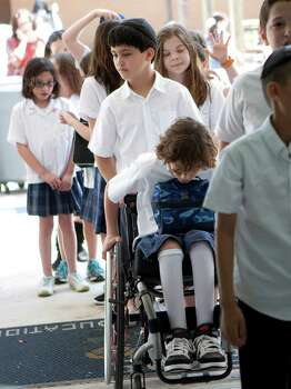 Peter Berry, 10, returns to class with his classmates after lunch at the Beth Yeshurun Day School. Photo: Johnny Hanson, Houston Chronicle / © 2012  Houston Chronicle