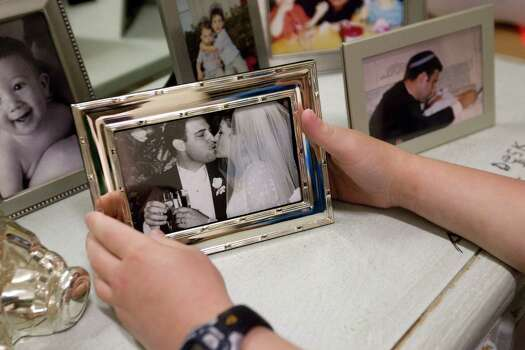 Aaron Berry, 9, said he is surrounded by his favorite pictures and mementoes from his mom and dad in his room including his parents wedding picture, his favorite. Photo: Johnny Hanson, Houston Chronicle / © 2012  Houston Chronicle