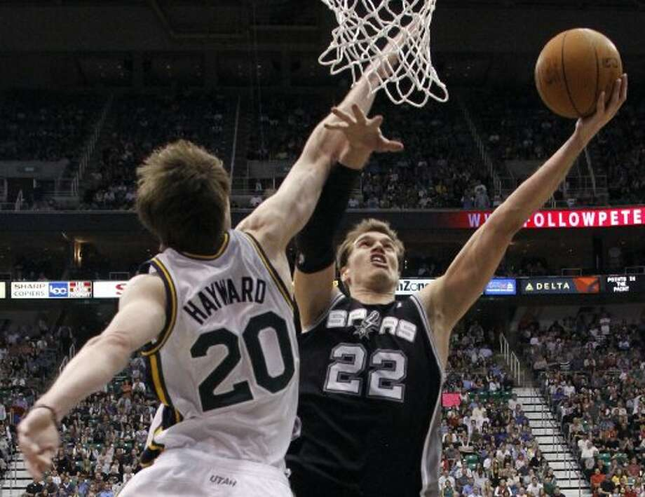 The top-seeded Spurs won three out of four against the eighth-seeded Jazz this season. Utah's only win in the series was 91-84 on April 9 in Salt Lake City, when Tim Duncan, Manu Ginobili and Tony Parker did not make the trip. Here, Spurs center Tiago Splitter (22) attempts a shot while defended by Utah Jazz guard Gordon Hayward during that game. (AP Photo/Jim Urquhart) (AP)