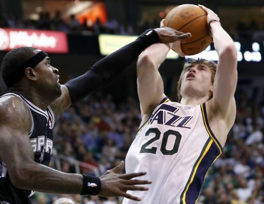 Jazz guard Gordon Hayward is the X-factor for the Jazz. The second-year swingman from Butler is averaging 17.2 points and shooting 50 percent from 3-point range in April. Here, Hayward (20) takes a shot while defended by Spurs guard Stephen Jackson during the second half of a game Monday, April 9, 2012, in Salt Lake City. The Jazz won 91-84. (AP Photo/Jim Urquhart) (AP)