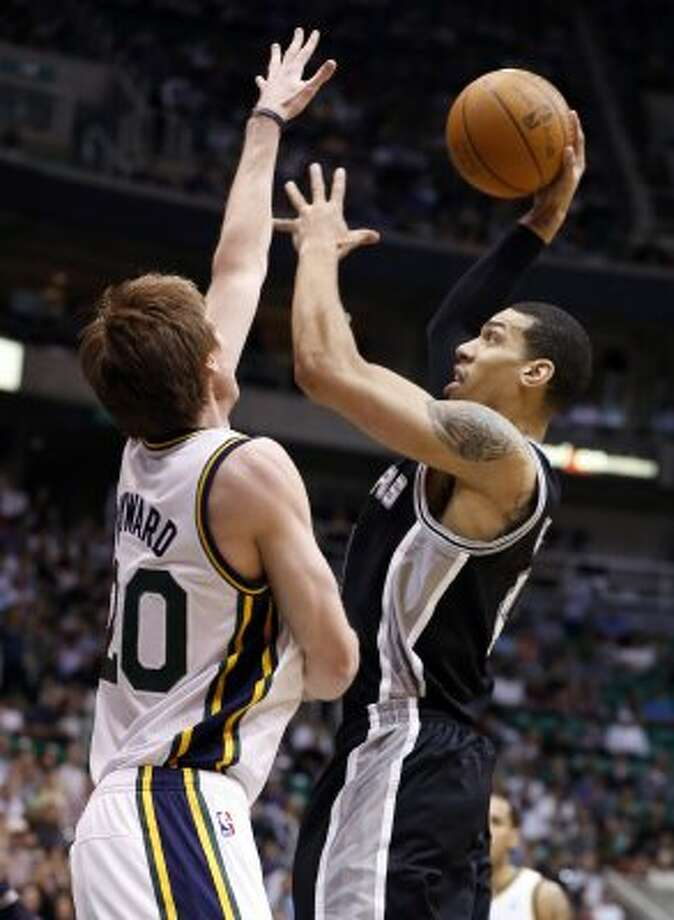 Spurs guard Danny Green, right, shoots over Jazz guard Gordon Hayward during the first half of a game Monday, April 9, 2012, in Salt Lake City. Utah won 8 of 12 in April, and finished on a four-game winning streak. (AP Photo/Jim Urquhart) (AP)