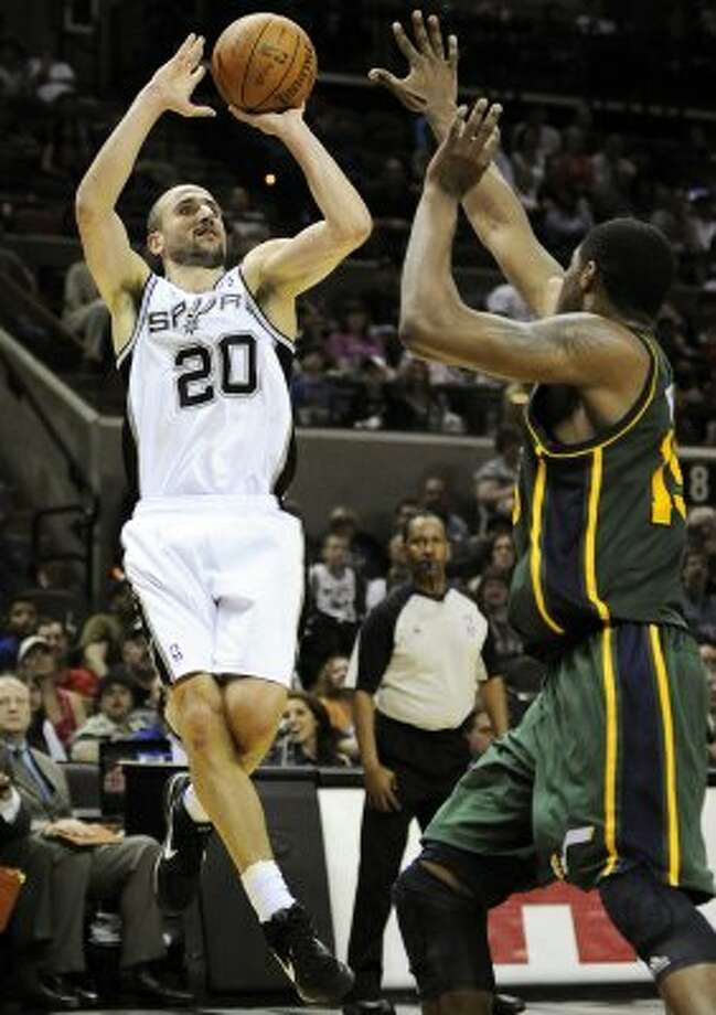The Spurs' Manu Ginobili (20) shoots over the Jazz's Derrick Favors during the second half of a game, Sunday, April 8, 2012, in San Antonio. San Antonio won 114-104. The Spurs are the NBA's top 3-point team at 39.5 percent. (AP Photo/Darren Abate) (AP)