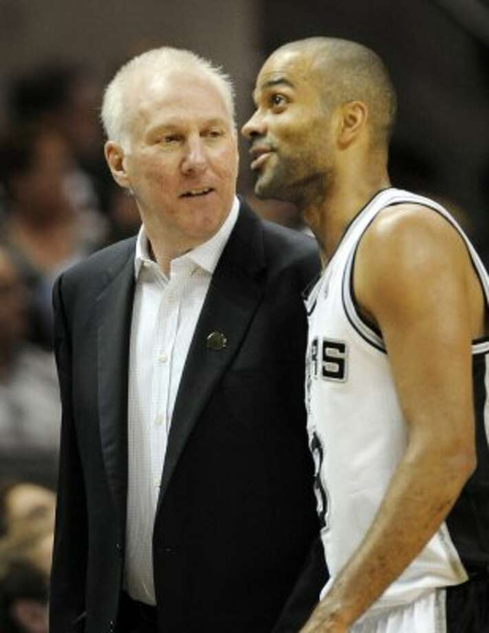 Spurs head coach Gregg Popovich, left, talks to Tony Parker during the first half of a game against the Utah Jazz, Sunday, April 8, 2012, in San Antonio. (AP Photo/Darren Abate) (AP)