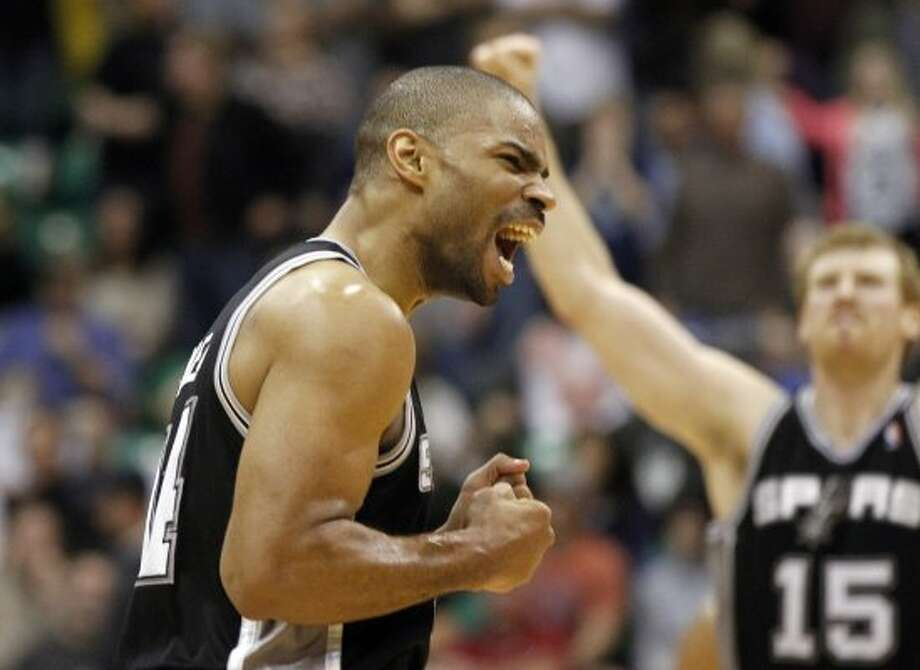 Spurs guard Gary Neal, left, and forward Matt Bonner (15) celebrate after a play during the second half of a game against the Jazz, Monday, Feb. 20, 2012, in Salt Lake City. The Spurs won 106-102. (AP Photo/Jim Urquhart) (AP)
