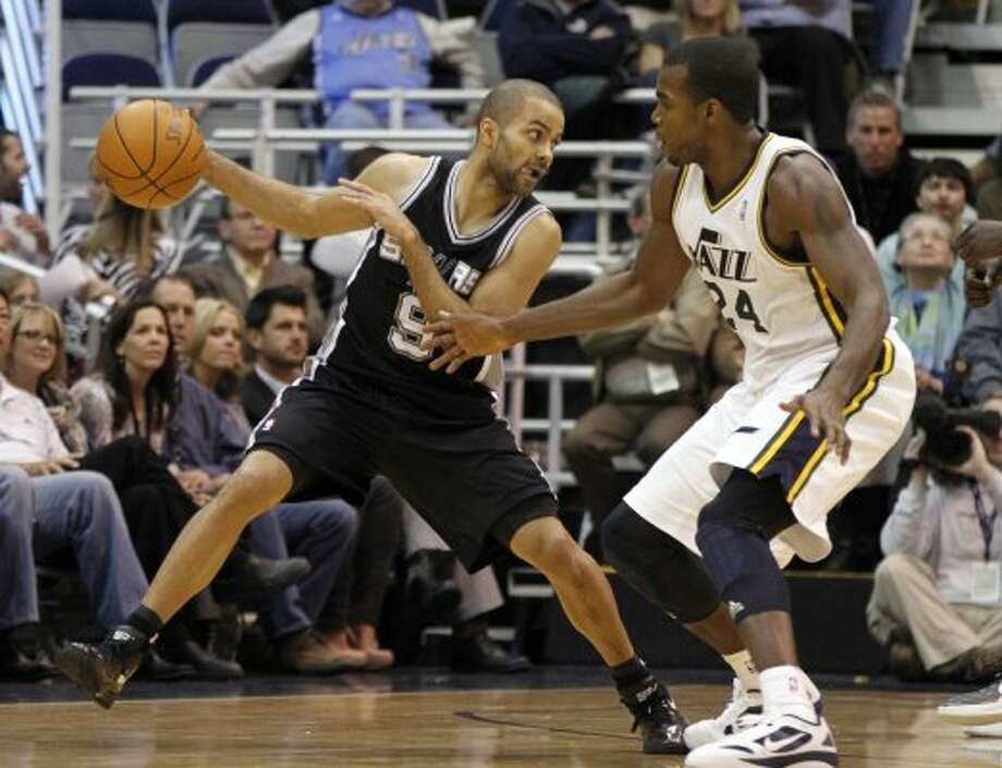 Spurs guard Tony Parker (9) works to get around Jazz forward Paul Millsap (24) during the second half on a game, Monday, Feb. 20, 2012, in Salt Lake City. The Spurs won 106-102. (AP Photo/Jim Urquhart) (AP)