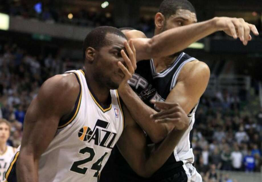 Jazz forward Paul Millsap (24) and Spurs forward Tim Duncan (21) jockey for position during the second half of a game, Monday, Feb. 20, 2012, in Salt Lake City. The Spurs won 106-102. (AP Photo/Jim Urquhart) (AP)