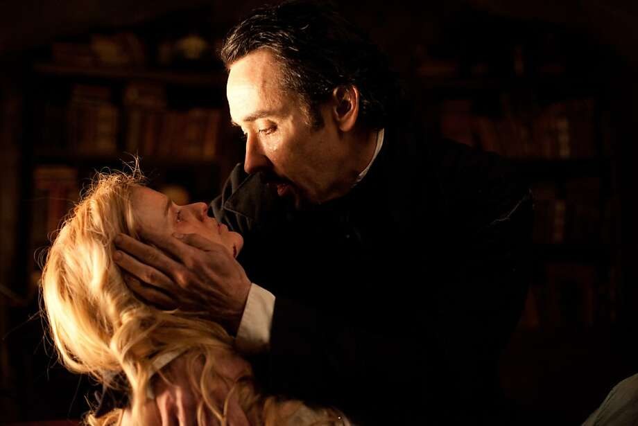 (Left to right.) Alice Eve and John Cusack star in Relativity Media's stylish gothic thriller The Raven. Photo: Larry Horricks, Relativity Media