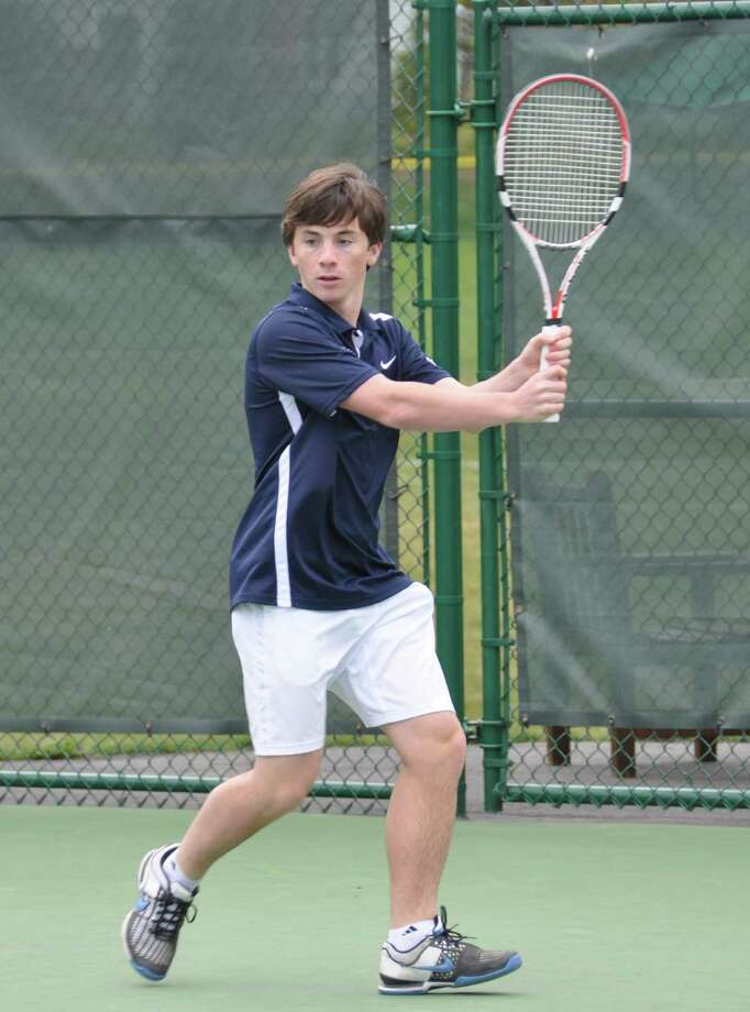 Greens Farms Academy's Clay Garner of Westport awaits a shot at second doubles last week. Garner and his partner Spencer Hartig won all three matches. Photo: Contributed Photo