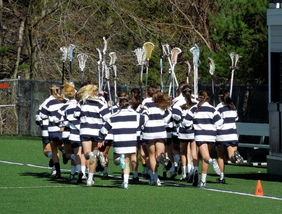 The Staples girls lacrosse team warms up before its April 5 game against Guilford. Staples lost 17-7 at New Canaan Tuesday and hopes to get back on the winning track Friday against Fairfield Warde. Photo: Nancy Crofts / Contributed Photo