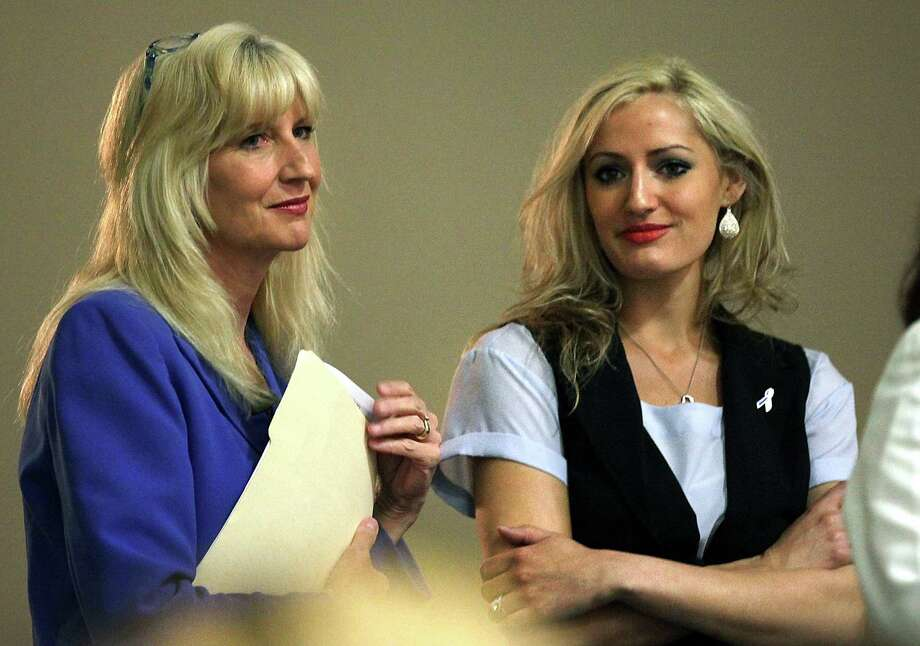 Kelli Quinn (left) fights back tears as she joins daughter Jenna Quinn onstage at The ChildSafe Conference at El Tropicano Riverwalk Hotel. Photo: BOB OWEN, San Antonio Express-News / © 2012 San Antonio Express-News