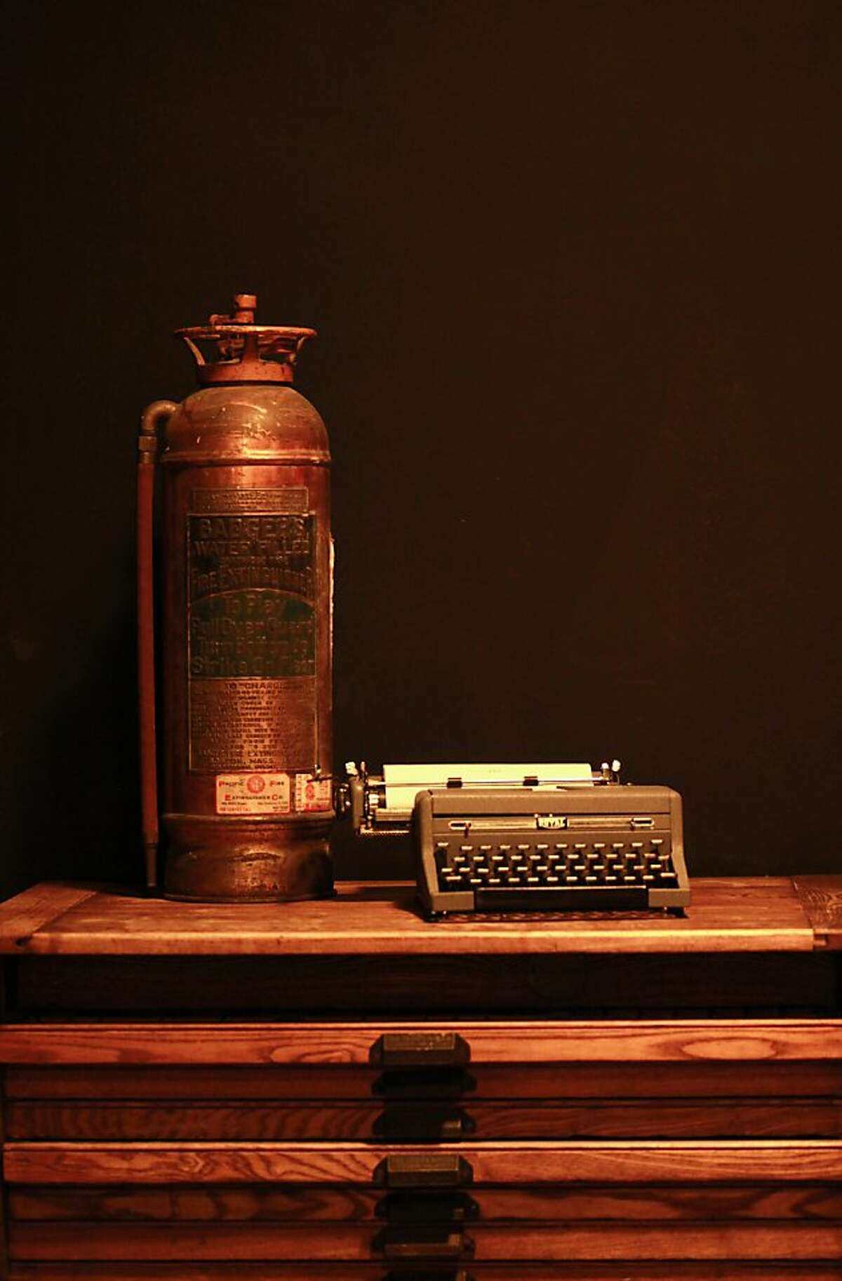Inside of the new Local Edition bar are old fashioned typewriters and fire extinguishers, in San Francisco, California on Friday, April 13, 2012.