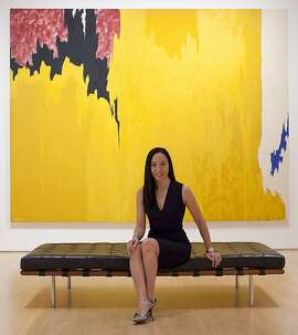 "Plastic surgeon Dr. Carolyn Chang is seen in front of Clifford Still's, ""Untitled,"" Oil on Canvas, 1957 at SFMOMA on Wednesday, March 7, 2012 in San Francisco, Calif."