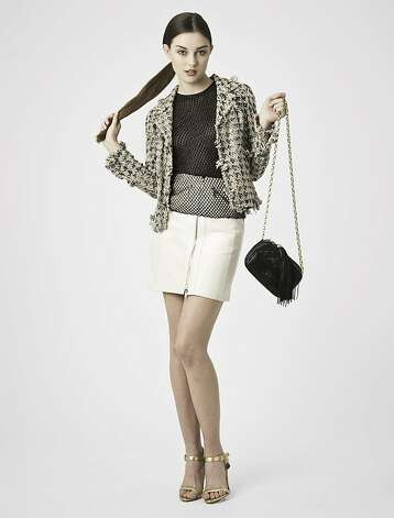 A representative look from TheRealReal.com, a designer resale website: Chanel jacket ($995), Emanuel Ungaro beaded top ($175), Celine skirt ($225), Ralph Lauren Purple Label Gold sandals ($175), Chanel quilted handbag ($795). Photo: TheRealReal.com