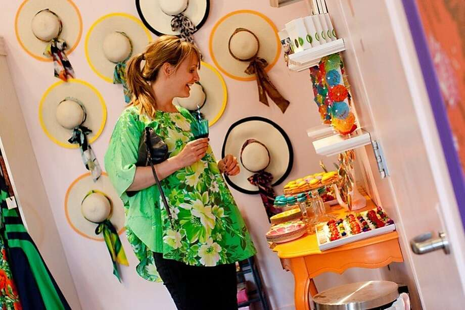 The launch of the Trina Turk pop-up at Napa's Cake Plate boutique drew a festive crowd April 5. Marina Stiefuter admiring the brightly colored hors d'oeuvres and dessert table. Photo: Jen Heffner Photography