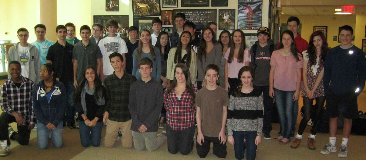 A group portrait of the 16 sets of twins in the Staples High School sophomore class, which expects to win certification from the Guinness Book of World Records for the figure.