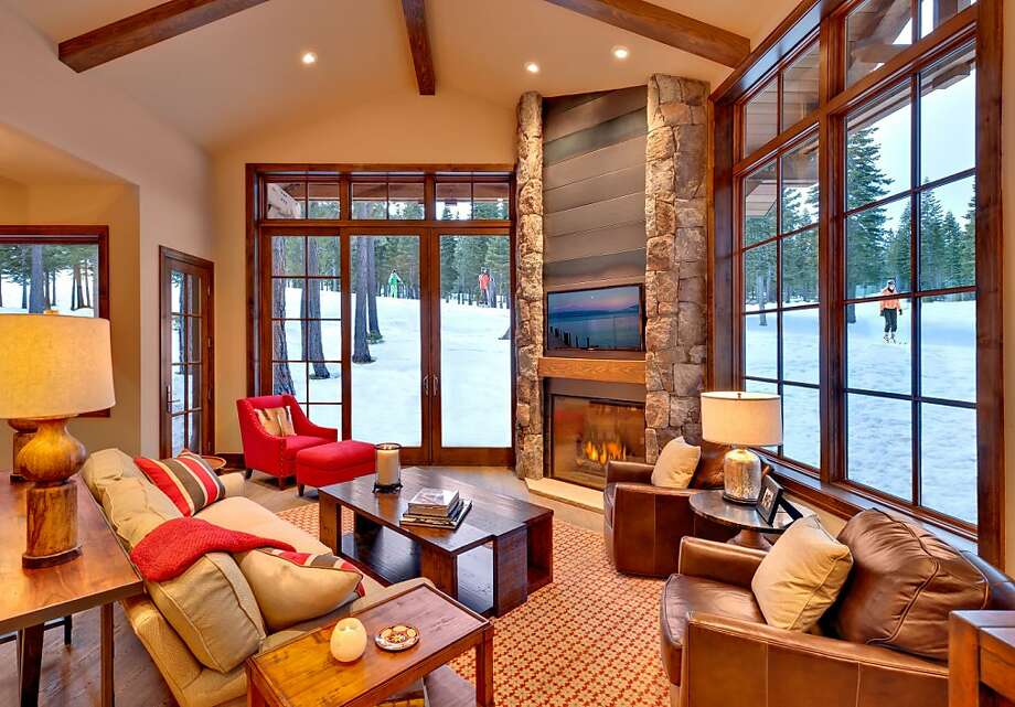 A fireplace in the great room offers winter warmth, while the ski slopes and trails of Tahoe are literally right outside the front door. Photo: Vance Fox