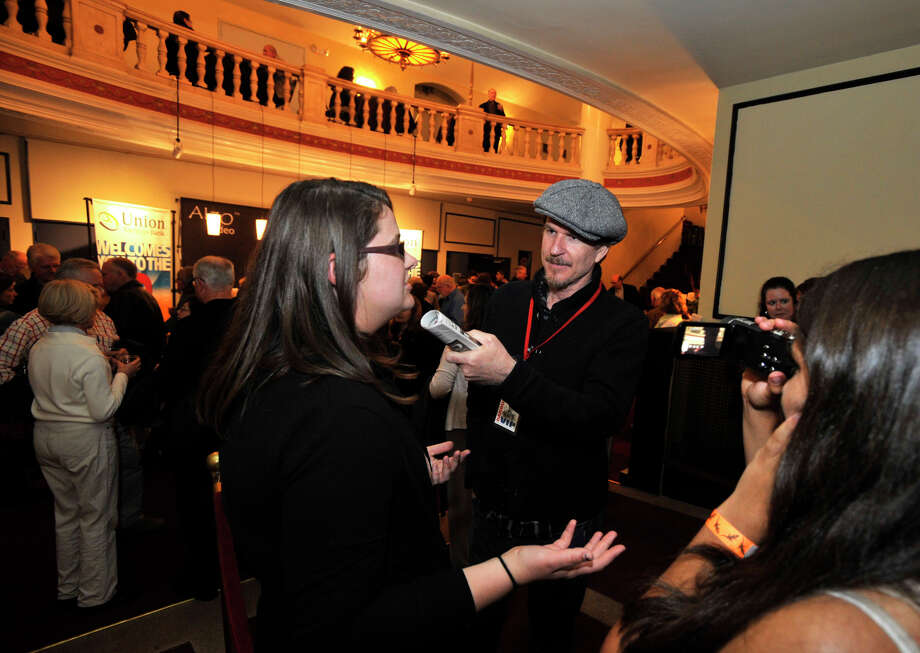 From left, Brianna Schorr speaks with Matthew Modine as Gina Atanasoff films them during the Connecticut Film Festival's pre-show reception at the Palace Theatre in Danbury, Conn., on Thursday, April 26, 2012. Schorr and Atanasoff are volunteers making video clips for the festival website. Photo: Jason Rearick / The News-Times