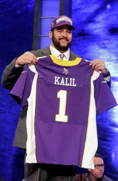 Southern California offensive lineman Matt Kalil poses for photographs after being selected as the f