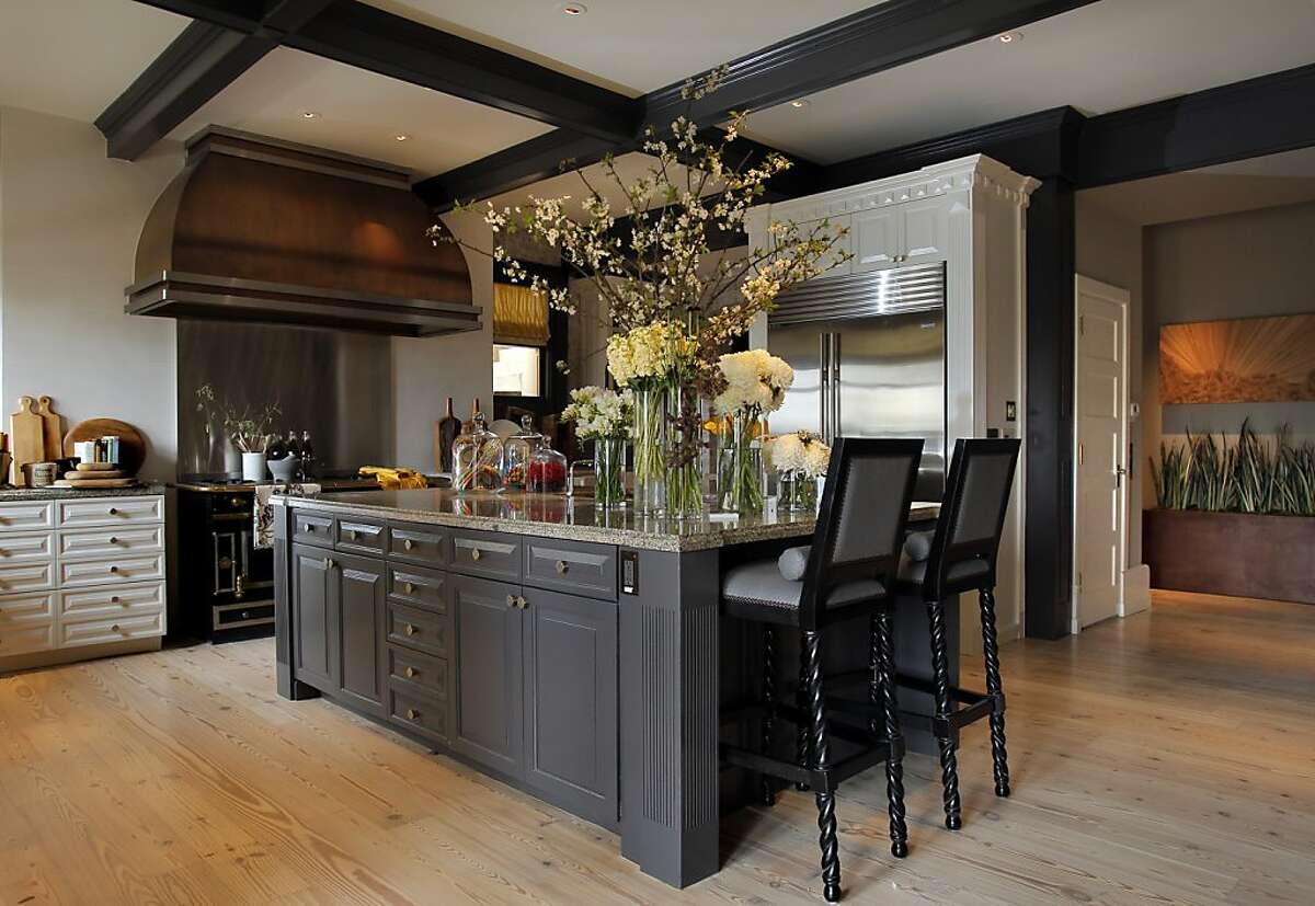 The 2012 San Francisco Decorator Showcase at 2020 Jackson Street features work by dozens of the area's best decorators including a kitchen and family room by Jeff Schlarb and Tray Schlarb of green couch.