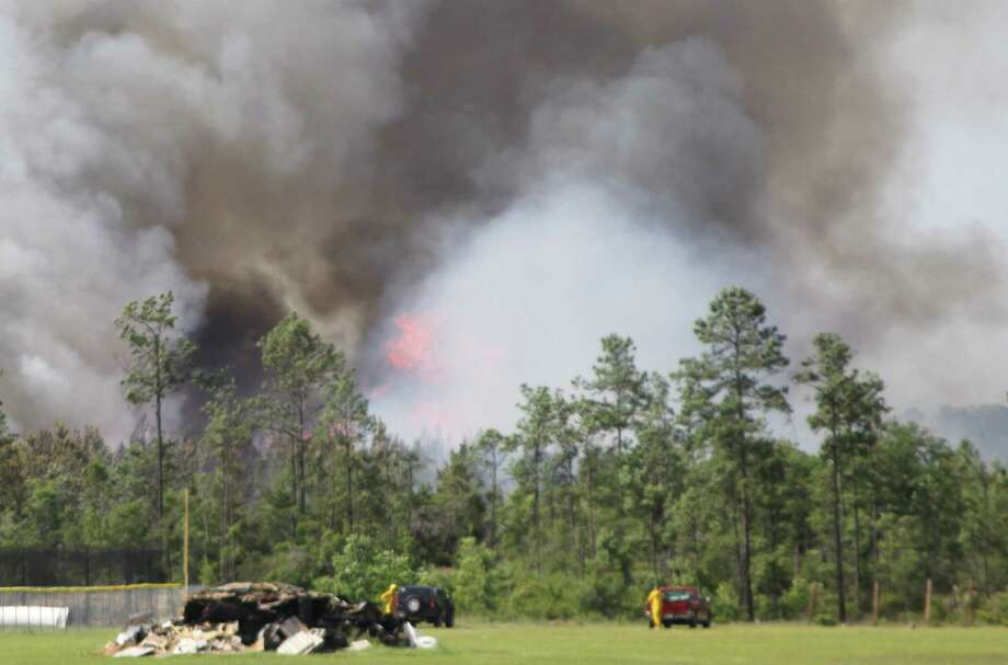 A 100-plus acre wildfire burns in Hardin County on Thursday, April 26. Six separate fires started along a five mile stretch of railroad tracks between Kountze and Honey Island Thursday afternoon, which continue to burn late into the evening. Photo: David Lisenby, HCN_Brush Fire 4-26
