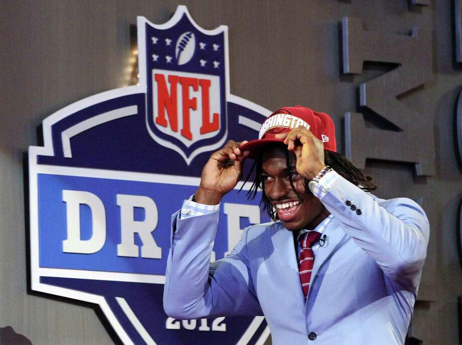 Baylor quarterback Robert Griffin III walks on stage after he was selected as the second pick overall by the Washington Redskins in the first round of the NFL football draft at Radio City Music Hall, Thursday, April 26, 2012, in New York. Photo: AP