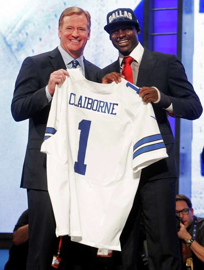 LSU cornerback Morris Claiborne, right, poses for photographs with NFL Commissioner Roger Goodell after being selected as the sixth pick overall by the Dallas Cowboys in the first round of the NFL football draft at Radio City Music Hall, Thursday, April 26, 2012, in New York. Photo: AP