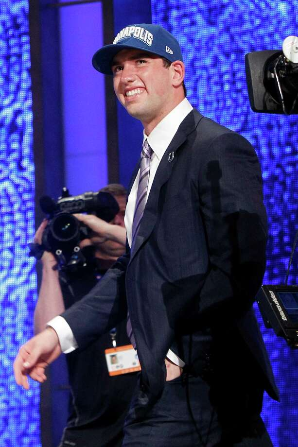 Stanford quarterback Andrew Luck walks on stage after he was selected as the first pick overall by the Indianapolis Colts in the first round of the NFL football draft at Radio City Music Hall, Thursday, April 26, 2012, in New York. Photo: AP