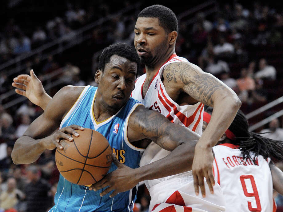New Orleans Hornets' Al-Farouq Aminu, left, pushes against Houston Rockets' Greg Smith during the first half of an NBA basketball game Thursday, April 26, 2012, in Houston. (AP Photo/Pat Sullivan) Photo: Pat Sullivan, Associated Press / AP