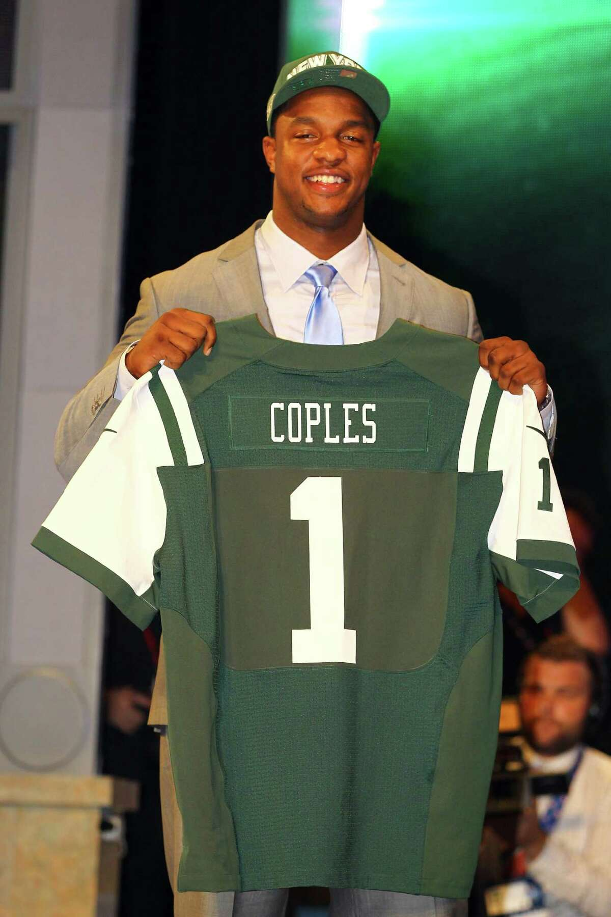 NEW YORK, NY - APRIL 26: Quinton Coples of North Carolina holds up a jersey as he stands on stage after he was selected #16 overall by the New York Jets in the first round of the 2012 NFL Draft at Radio City Music Hall on April 26, 2012 in New York City. (Photo by Al Bello/Getty Images)
