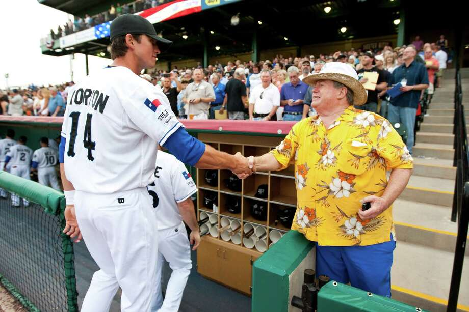 Dave Stromatt, a Sugar Land Skeeters fan, wishes Colt Morton good luck as he stands by the dug out before the Skeeters' inaugural game, Thursday, April 26, 2012, at Constellation  Field in Houston. Photo: Nick De La Torre, Houston Chronicle / © 2012  Houston Chronicle