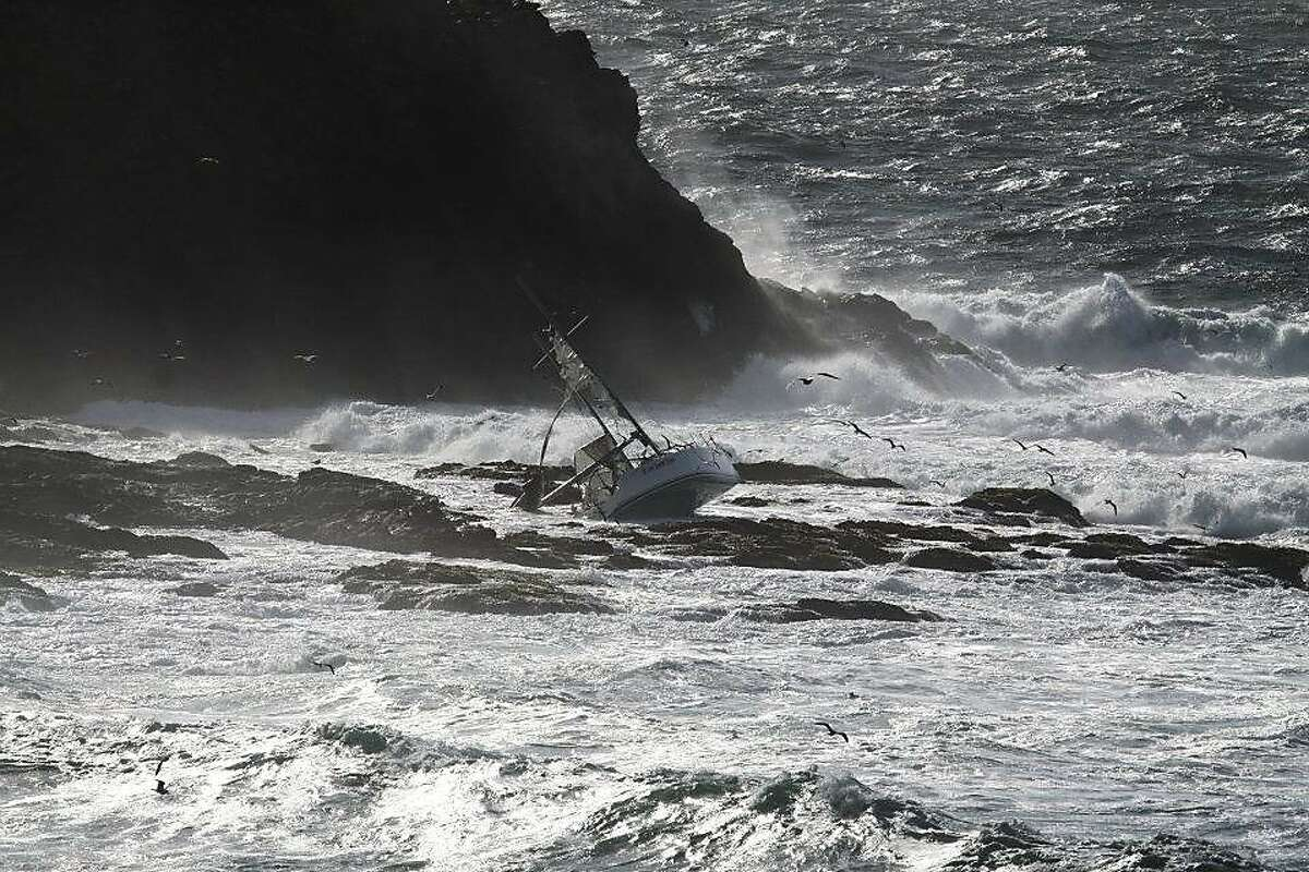 This photo shows The Low Speed Chase, a 38-foot sailboat from the San Francisco Yacht Club in Belvedere, on Saturday, April 14, after it was slammed broadside by a 12-foot wave as it rounded the Farallones during the Full Crew Farallones Race. Five of eight crew members washed overboard, and the boat crashed into the rocks.