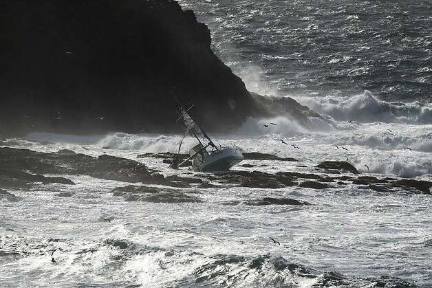 This photo shows The Low Speed Chase, a 38-foot sailboat from the San Francisco Yacht Club in Belvedere, on Saturday, April 14, after it was slammed broadside by a 12-foot wave as it rounded the Farallones during the Full Crew Farallones Race. Five of eight crew members washed overboard, and the boat crashed into the rocks. Photo: Sophie Webb, Special To The Chronicle