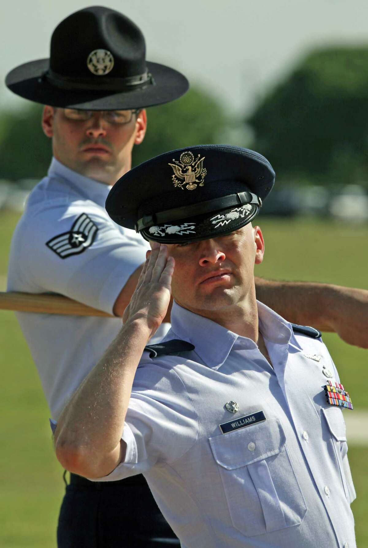 Lt. Col Christopher Williams of CA, salutes as he leads his squadron at the Lackland AFB Fiesta Military Parade, Wednesday, April 25, 2012.
