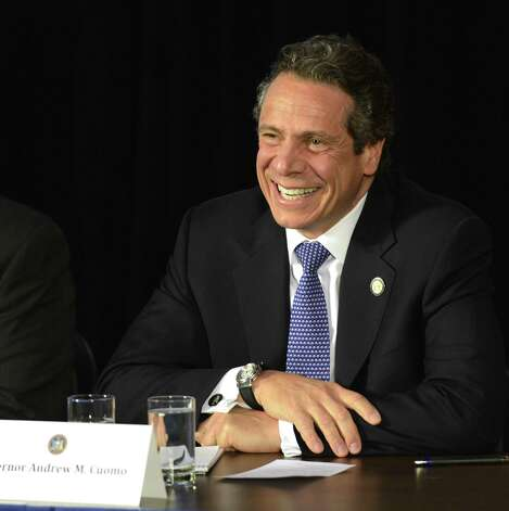 Governor Andrew Cuomo shares a funny moment during a meeting of his cabinet in the Red Room of the State Capitol in Albany, N.Y. April 26, 2012. (Skip Dickstein/Times Union) Photo: Skip Dickstein / 2012