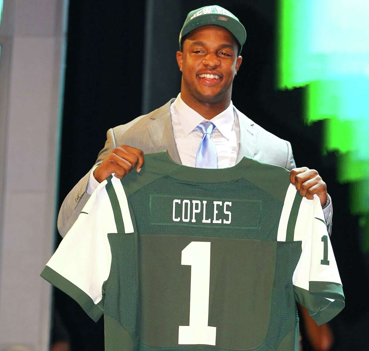 Quinton Coples of North Carolina poses with a Jets jersey after New York took him with the 16th pick in the NFL draft Thursday night in New York.
