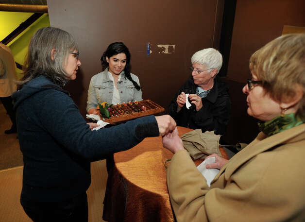 Cristina Siguenza, second from left, serves hors d'oeuvres to Dawn Nacewicz, left, Linda Aldo, third from left, and Anita Sansone during the Connecticut Film Festival's VIP reception at the Empress Professional Building in Danbury, Conn., on Thursday, April 26, 2012. Photo: Jason Rearick / The News-Times