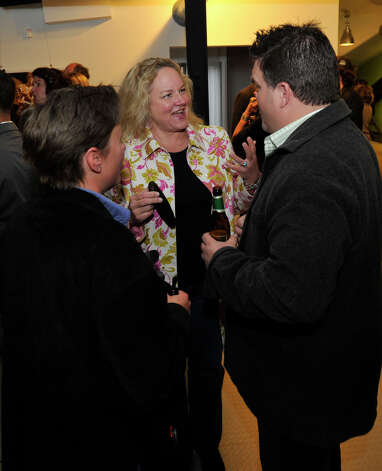 "From left, Lara Schuler, Leslie Verbitsky and Paul Verbitsky chat during the Connecticut Film Festival's VIP reception at the Empress Professional Building in Danbury, Conn., on Thursday, April 26, 2012. Leslie is Paul's sister-in-law. Paul is the producer and editor of ""Confidence Game,"" a film featured in the festival. Schuler works with Paul at Blue Chip Films. Photo: Jason Rearick / The News-Times"