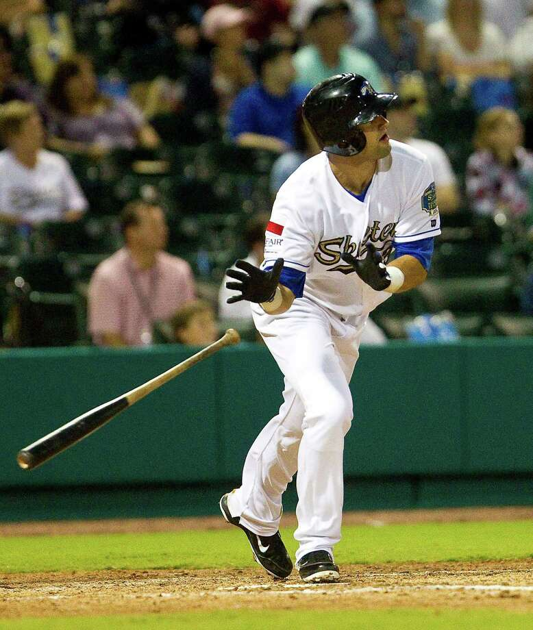 Ben Harrison of the Sugar Land Skeeters watches a two shot home run go over the fence during the seventh inning of the the Sugar Land Skeeters' inaugural game, Thursday, April 26, 2012, at Constellation  Field in Sugar Land. Photo: Nick De La Torre, Houston Chronicle / © 2012  Houston Chronicle