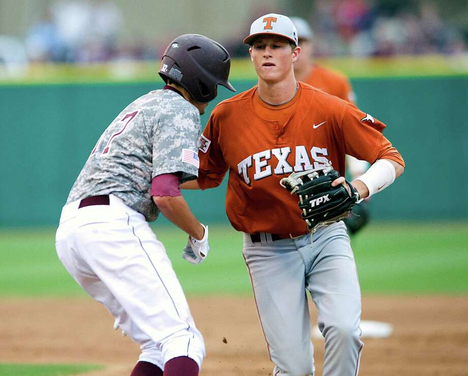 Texas' Erich Weiss, right, and Texas A&M's Matt Juengel might be playing in the final baseball series between the two schools this weekend. Photo: Stuart Villanueva / BRYAN COLLEGE STATION EAGLE