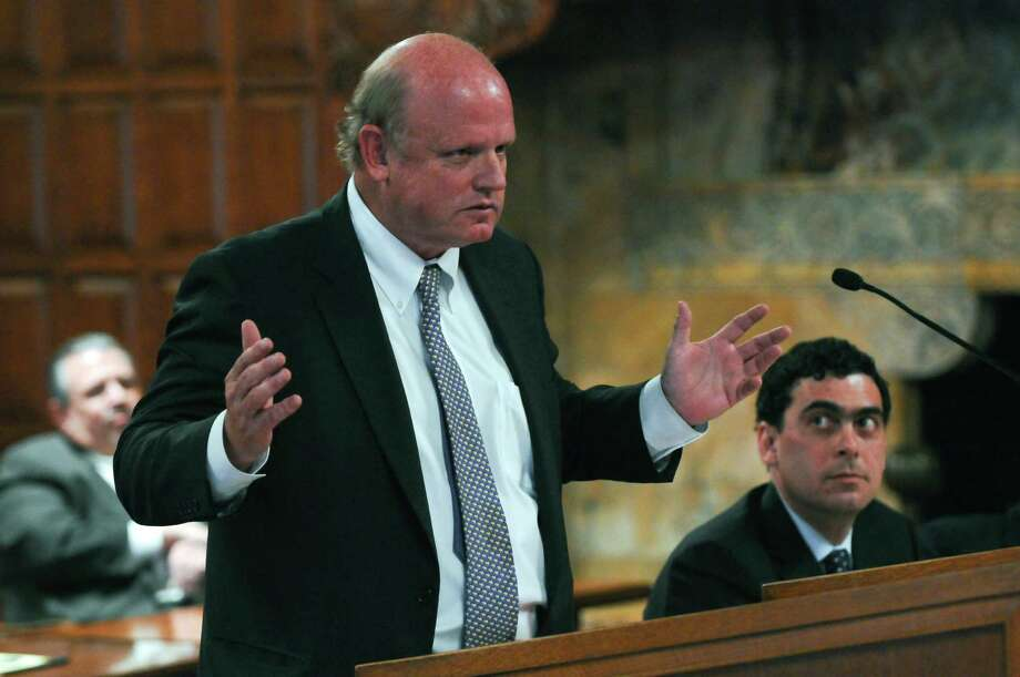 Attorney Michael Carvin, representing Senate Majority Leader Dean Skelos, left, makes his case to the New York State Court of Appeals, while his opponent Eric Hecker, right, listens, during a petition by representatives of the Democratic Senate minority to challenge the constitutional validity of legislation reapportioning State Senate districts based on the 2010 federal census, which increases the size of the Senate from 62 seats to 63, on Thursday April 26, 2012 in Albany, NY.  (Philip Kamrass / Times Union ) Photo: Philip Kamrass / 10017449A