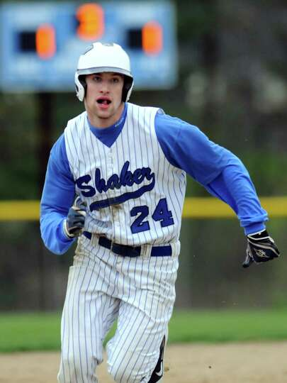 Shaker's Eric Egan (24) runs to third during their baseball game against Shenendehowa on Thursday, A