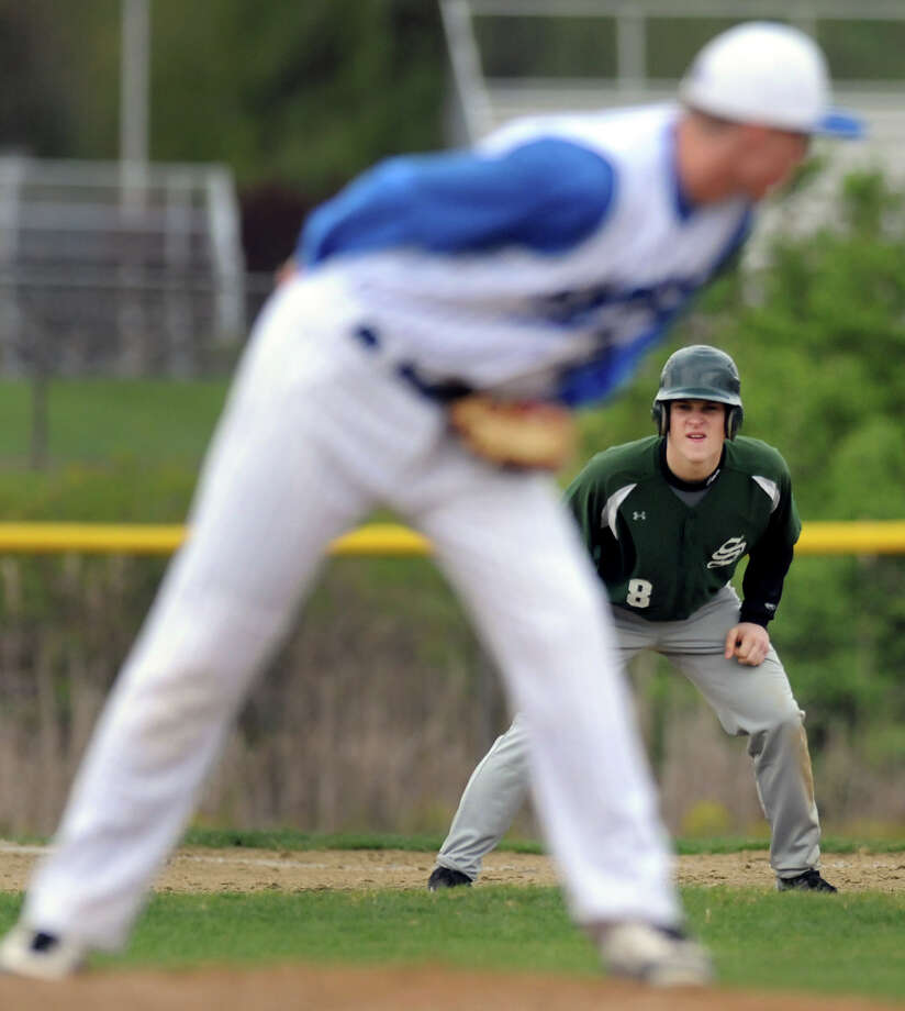 Shenendehowa's Matt Buckley (8) looks to steal second as Shaker's pitcher Chad Sinko checks the runner during their baseball game on Thursday, April 26, 2012, at Shaker High in Latham, N.Y. (Cindy Schultz / Times Union) Photo: Cindy Schultz / 00017395A