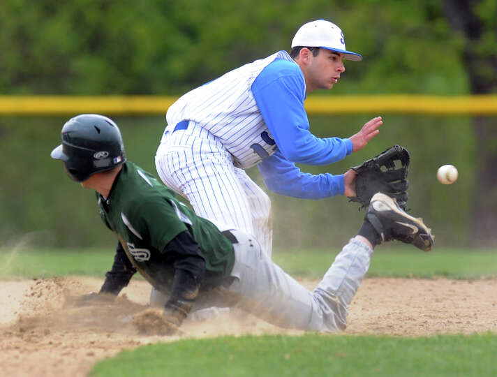 Shaker's Steve Boldish (14), center, stops the ball as Shenendehowa's Colton Robtoy (1) slides safel