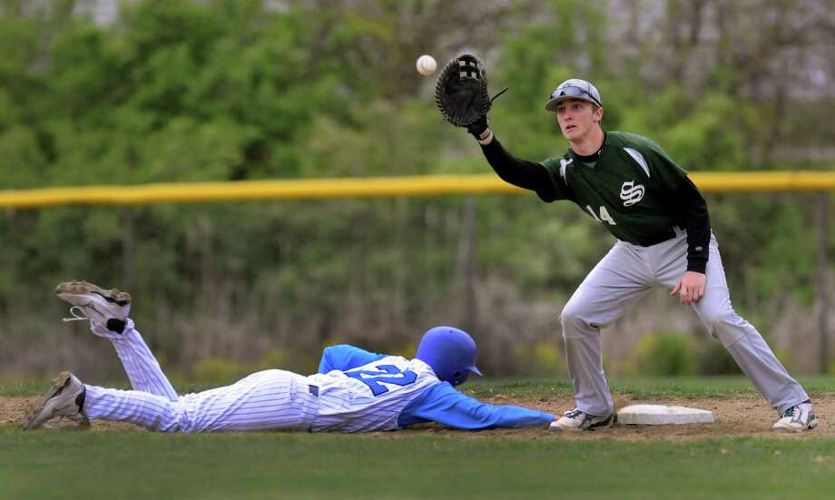 Shaker's Corey McMeel (22), left, dives back to first as Shenendehowa's Sam Halpern (14) makes the catch during their baseball game on Thursday, April 26, 2012, at Shaker High in Latham, N.Y. (Cindy Schultz / Times Union) Photo: Cindy Schultz / 00017395A